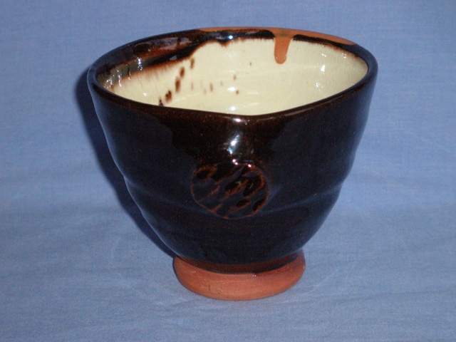 A Two Tone Brown and Cream Studio Pottery Bowl - Signed